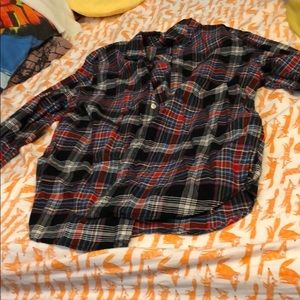 Red and black plaid men's flannel shirt. Size: XL